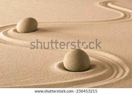 zen stones and lines in sand of Japanese garden. Purity harmony and balance.