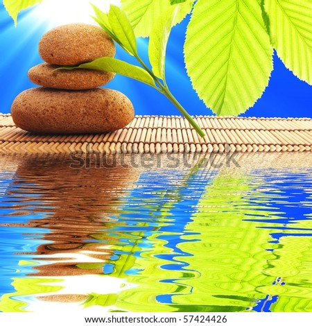 zen stones and water reflection showing spa concept - stock photo