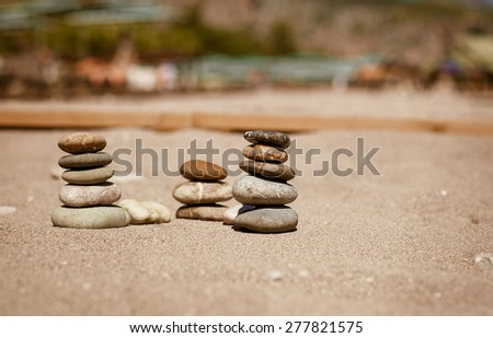 Zen Stones balance spa on beach pebbles stack on sand. stack of zen stones Beauty world. vacation concept. wellness and spa, series, selective focus - stock photo