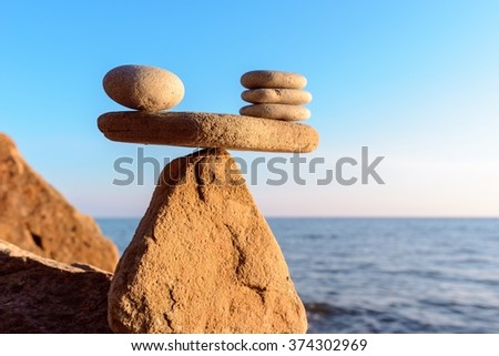 Zen stones in balance at seashore - stock photo