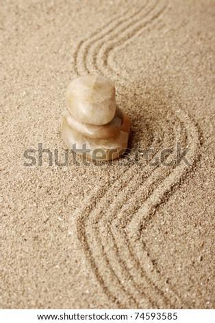 Zen stones in the sand - stock photo