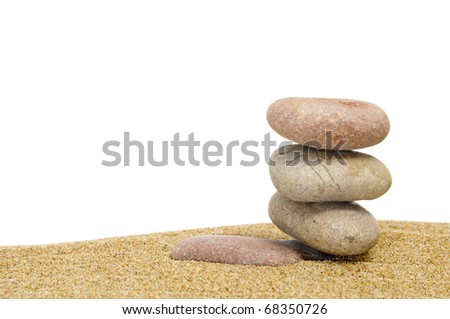 zen stones in the sand on a white background - stock photo