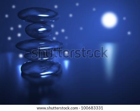 Zen stones in water and magic night - stock photo