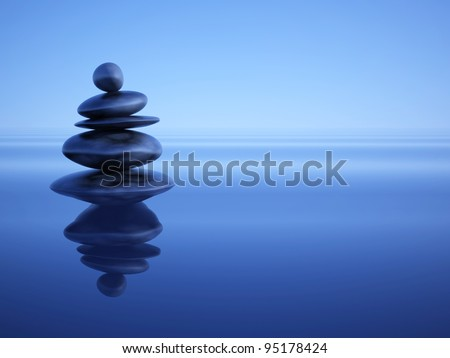 Zen stones in water under blue ambient light - stock photo