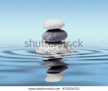 Zen stones in water with reflection - peace balance meditation relaxation concept - stock photo