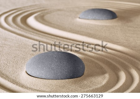 zen stones meditation and relaxation in Japanese zen garden. Stone and sand lines pattern background - stock photo