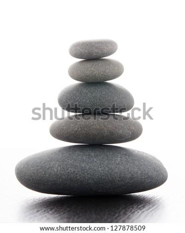 Zen stones on a wooden table - stock photo
