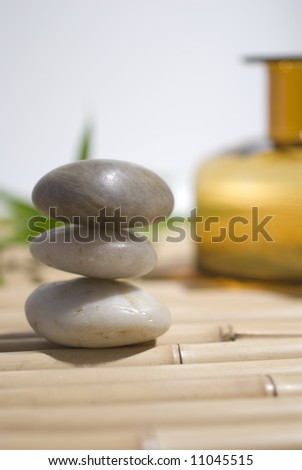 zen stones on bamboo background meditation concept
