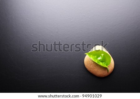 zen stones on black background showing spa concept with copyspace - stock photo