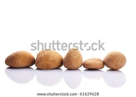 zen stones or pebbles isolated on white background - stock photo
