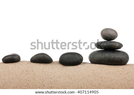 Zen stones pyramid on sand beach, meditation, concentration, relaxation, harmony, balance, isolated on a white background - stock photo