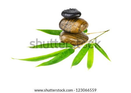 zen stones with bamboo leaves isolated on white - stock photo