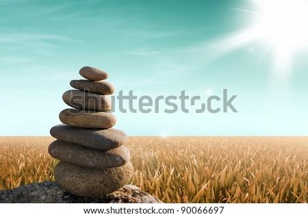 zen stones with grass field - stock photo