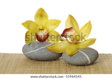 zen stones with orchid on straw mat - stock photo