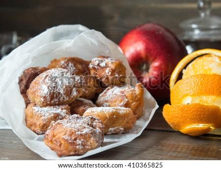 Zeppole with apple and orange  - stock photo