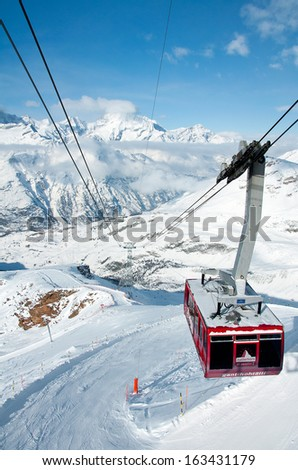 ZERMATT -?? JANUARY 17: Cable car climbing up from Gant to Hohtaelli on January 17, 2013 in Zermatt, Switzerland. It is 2707 metres long and spans an elevation of some 1057 metres. - stock photo