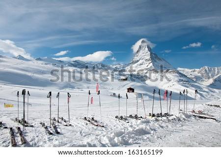 ZERMATT - JANUARY 17: Panorama of the Matterhorn ski paradise on January 17, 2013 in Switzerland. View from Riffelberg station. - stock photo