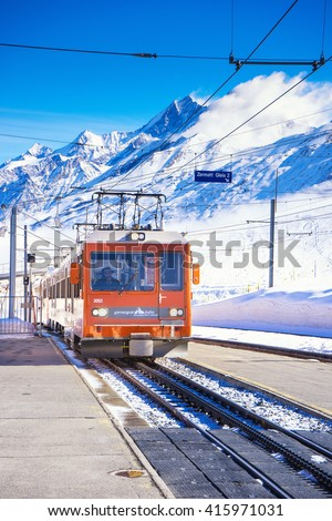 ZERMATT, SWITZERLAND -APRIL 13, 2016: A train arriving Gornergrat station, a summit station above Zermatt in Switzerland. - stock photo