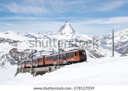 Zermatt, Switzerland - April 29, 2015-The train of Gonergratbahn running to the Gornergrat station in the famous touristic place with clear view to Matterhorn. - stock photo