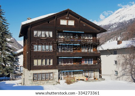 ZERMATT, SWITZERLAND - DECEMBER 08, 2009: Exterior of the traditional wooden chalet in Zermatt, Switzerland. Zermatt is a famous car-free ski resort in Switzerland.  - stock photo