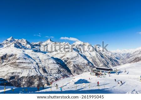 Zermatt, Switzerland - December 31, 2014 - Lots of skier having fun in the perfect area for winter sport - the slopes under the feet of Matterhorn. Photo taken near the station Riffelberg . - stock photo