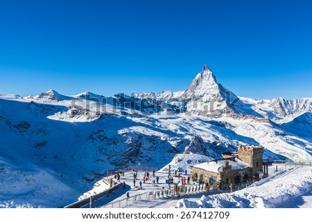 Zermatt, Switzerland - December 31, 2014 -The train station at Gonergrat with clear view to  Matterhorn. People strats to ski from here. - stock photo