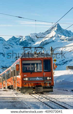 ZERMATT, SWITZERLAND - FEBRUARY 05, 2016: A Gornergratbahn train arriving at the summit station above Zermatt in Switzerland. - stock photo