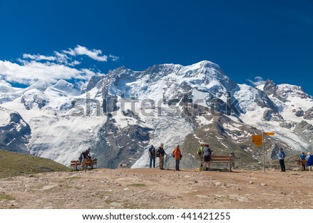 ZERMATT, SWITZERLAND - JUNE 24,2012: People were enjoying view of snow mountains near Matterhorn peak in Switzerland