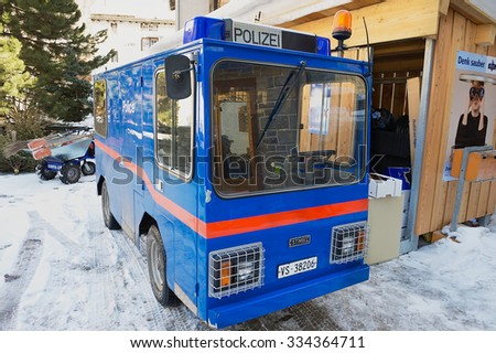 ZERMATT, SWITZERLAND - MARCH 03, 2009: Exterior of the electric police car parked at the street in Zermatt, Switzerland. Zermatt is a famous car-free ski resort in Switzerland.  - stock photo