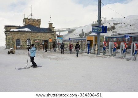 ZERMATT, SWITZERLAND - MARCH 04, 2009: Unidentified people walk at the upper Gornergratbahn railway station in Zermatt, Switzerland. - stock photo