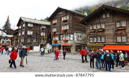 ZERMATT, SWITZERLAND - SEP 18: The mountain ski resort town of Zermatt, Switzerland, located at the base of Matterhorn, Switzerland's most iconic mountain and tourist magnet on Sep 18, 2011. - stock photo