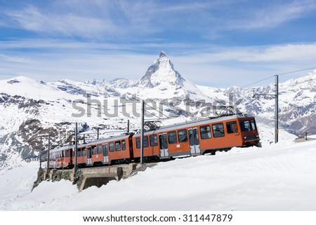 Zermatt, Switzerland -The train of Gonergratbahn running to the Gornergrat station in the famous touristic place with clear view to Matterhorn. - stock photo