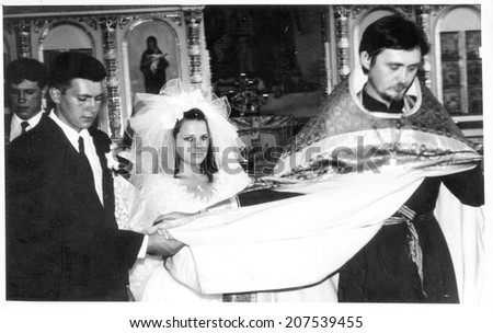 Zernograd, Russia - CIRCA 1992: the photo made in Russia, represents wedding couple during wedding, circa 1992.