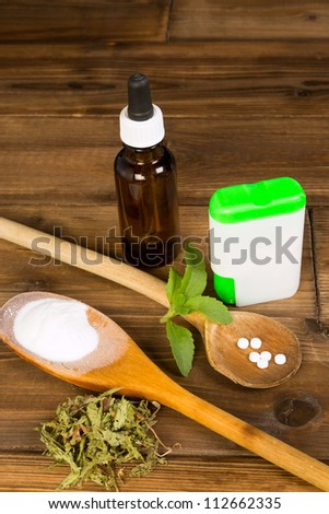 Zero-calorie sweetener stevia as tabs, dried, liquid and powder - stock photo