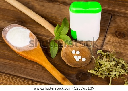 Zero-carb sweetener stevia as powder, tabs and dried leaves - stock photo