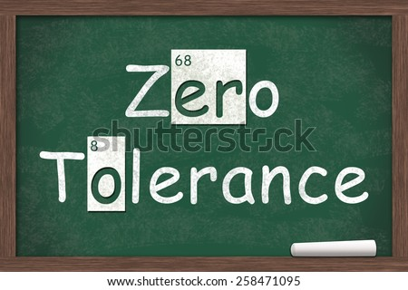 Zero Tolerance, Zero Tolerance written on a chalkboard with letters from the periodic table and a piece of white chalk - stock photo