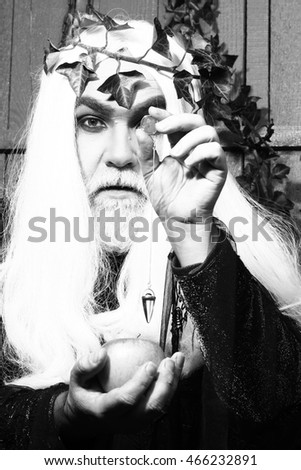 Zeus god or jupiter with enchanted apple in studio, black and white