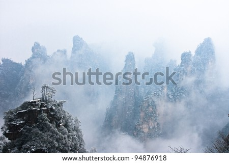 zhangjiajie national park in winter with snow and fog,Hunan China - stock photo