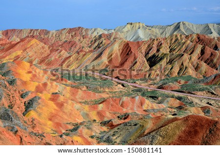 ZHANGYE, CHINA -Â?Â? JULY 27:  Danxia landform on July 27, 2013 in Zhangye, China. Danxia landform is formed from red sandstones and conglomerates of largely Cretaceous age. - stock photo