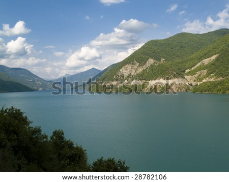 Zhinvali lake in Goergia. White clouds sunny summer day