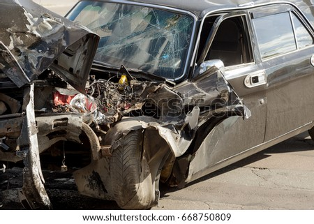ZHITOMIR, UKRAINE - June 20, 2017: broken car as result of road accident at crossroads of motorway. Accident. Road accident, car accident, collision of cars, insurance case on highway