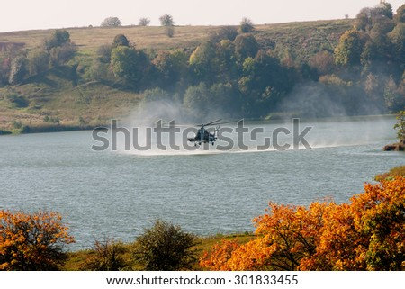 Zhitomir, Ukraine - 27 September 2012. Military Mi-8 helicopter flying over water