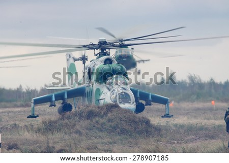 Zhitomir, Ukraine - September 29, 2010: Ukrainian Army Mi-24's Attack Helicopters during military training - stock photo
