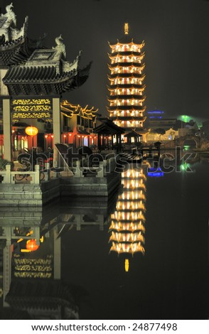 Zhouzhuang, famous water township in China, situated in Kunshan City which is only 30 kilometers southeast of Suzhou. Evening in the village Zhouzhuang with illuminated Pagoda at waterside