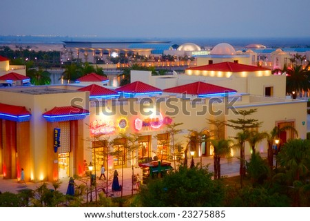 ZHUHAI, CHINA - JAN 12: The brightly lit downtown shopping center in fisherman wharf as seen on January 12, 2008, in Zhuhai, China. - stock photo
