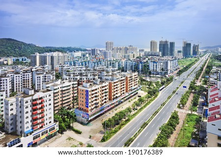 ZHUHAI-CHINA-JULY 4, 2012. Suburb with new constructed apartment buildings. Real estate is booming in China, developers are snapping up land for high-rises, and the banks are eagerly funding them.
