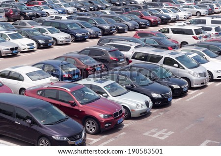 ZHUHAI, CHINA - MAY 2. Rows of the number of cars parked in a public parking lots in the holidays. Zhuhai, May 2, 2014 - stock photo