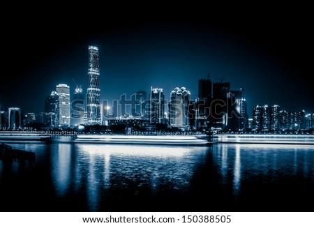 Zhujiang River and modern building of financial district at night in guangzhou china. - stock photo