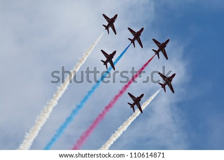 ZHUKOVSKIY, RUSSIAN FEDERATION - AUGUST 11: Royal Air Force Aerobatic Team in formation on 100 Years Air Force Celebration on August 11, 2012, Zhukovskiy, Russia.