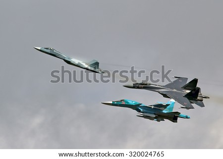 ZHUKOVSKY - AUGUST 26, 2015: Modern Russian fighters: T-50, SU-35, SU-34 shows demonstration flight at MAKS 2015.